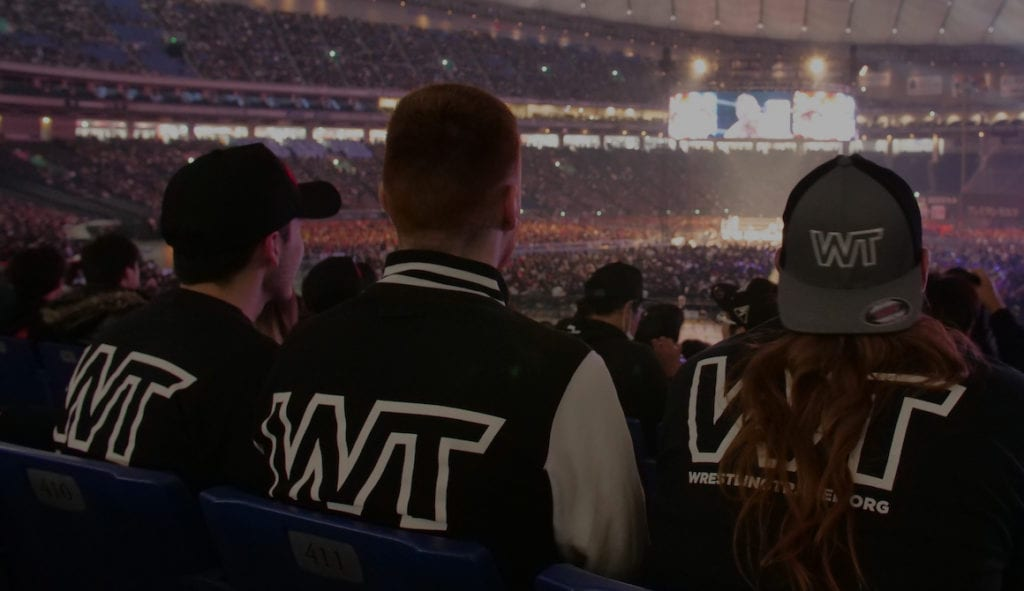 Wrestling Travel attendees watching a live event