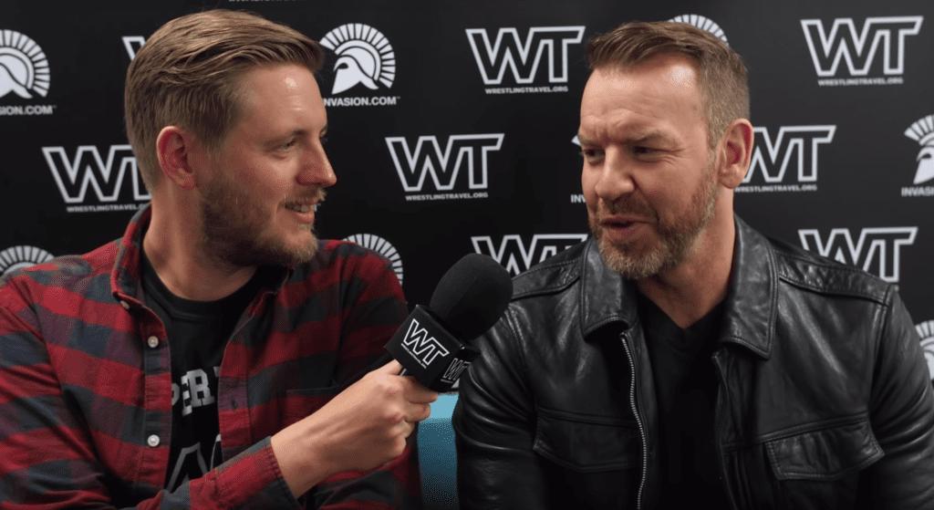 Wrestling Travel staff member hosting an interview